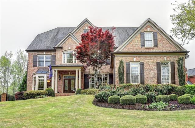 7055 Laurel Oak Drive, Suwanee, GA 30024 (MLS #6003250) :: The Zac Team @ RE/MAX Metro Atlanta
