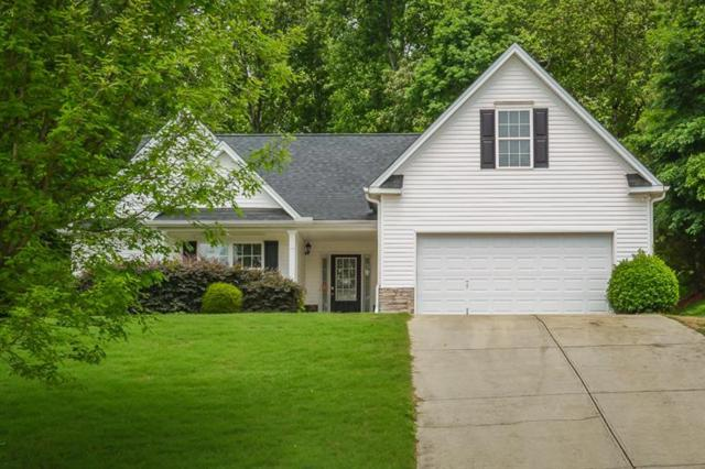 6724 Carriage Walk Lane, Flowery Branch, GA 30542 (MLS #6016462) :: The Russell Group