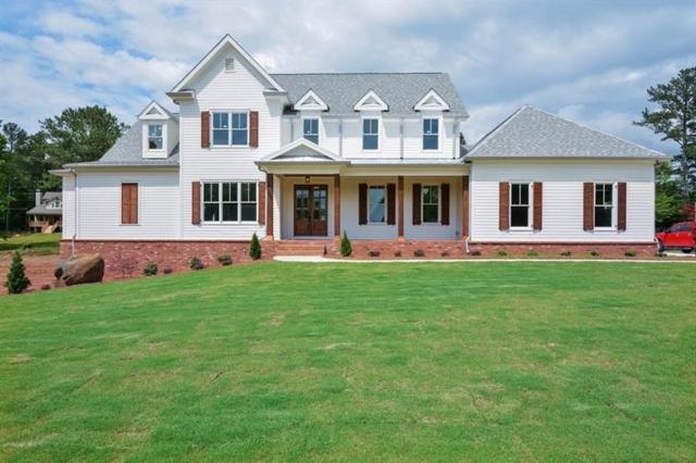 100 Millers Pointe, Woodstock, GA 30188 (MLS #6019719) :: RCM Brokers