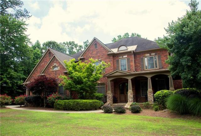 1028 Windsor Green Drive, Canton, GA 30115 (MLS #6035781) :: Path & Post Real Estate