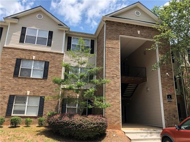 7302 Par Four Way, Lithonia, GA 30038 (MLS #6036388) :: The Justin Landis Group