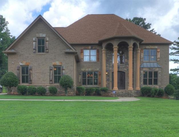 694 Old Cumming Road, Sugar Hill, GA 30518 (MLS #6037666) :: North Atlanta Home Team