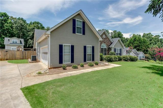 6333 Wilmington Way, Flowery Branch, GA 30542 (MLS #6038852) :: RCM Brokers