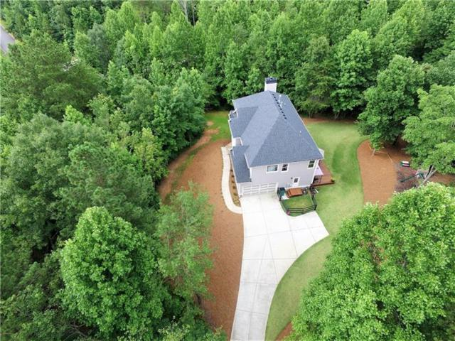 707 Carriage Way, Ball Ground, GA 30107 (MLS #6039960) :: The Bolt Group