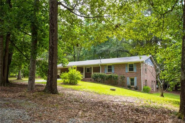 8451 Pleasant Hill Road, Lithonia, GA 30058 (MLS #6046518) :: RE/MAX Paramount Properties