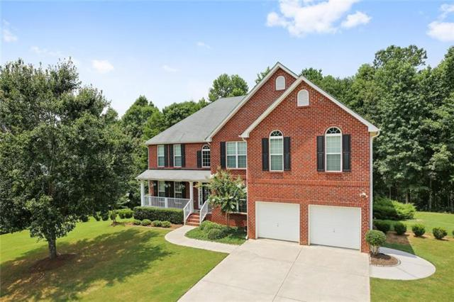 5440 Pleasant Woods Drive, Flowery Branch, GA 30542 (MLS #6051019) :: The Cowan Connection Team