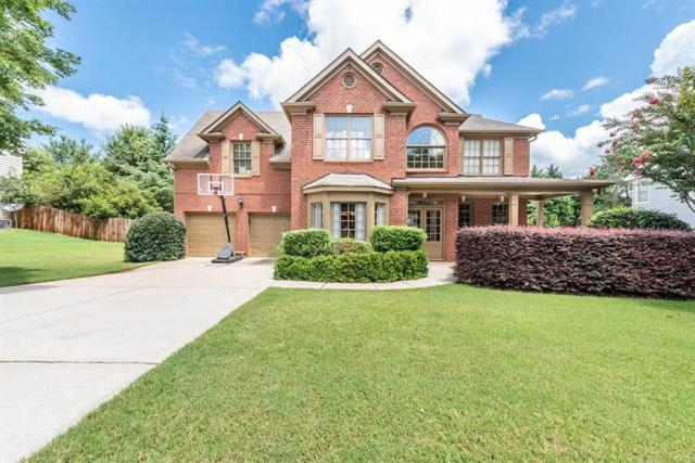 6565 Grand Magnolia Drive, Sugar Hill, GA 30518 (MLS #6053688) :: North Atlanta Home Team