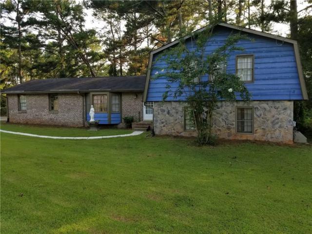 3957 Yellow Pine Drive SW, Lilburn, GA 30047 (MLS #6058458) :: North Atlanta Home Team
