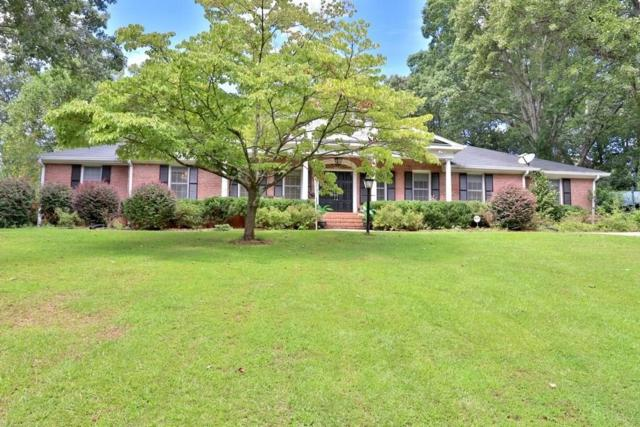 1494 Spalding Drive, Sandy Springs, GA 30350 (MLS #6066097) :: North Atlanta Home Team