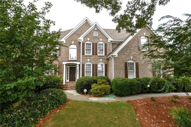 4040 Regal Oaks Drive, Suwanee, GA 30024 (MLS #6068109) :: The Russell Group