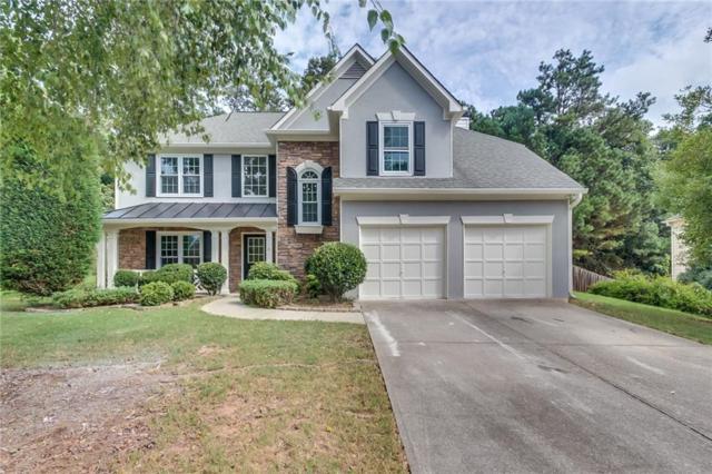 5207 Running Doe Drive, Suwanee, GA 30024 (MLS #6074084) :: North Atlanta Home Team