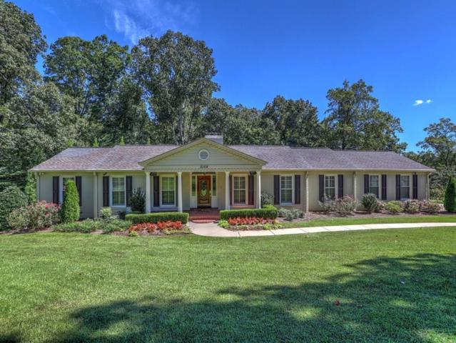 3158 Beechwood Drive SE, Marietta, GA 30067 (MLS #6074143) :: Dillard and Company Realty Group