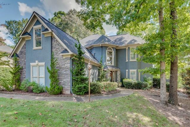 1095 Towne Lake Hills E, Woodstock, GA 30189 (MLS #6077641) :: The Zac Team @ RE/MAX Metro Atlanta
