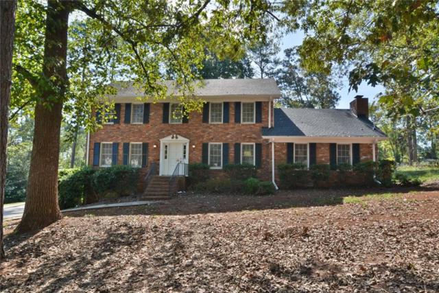 4426 Cedar Wood Drive SW, Lilburn, GA 30047 (MLS #6083606) :: The Zac Team @ RE/MAX Metro Atlanta