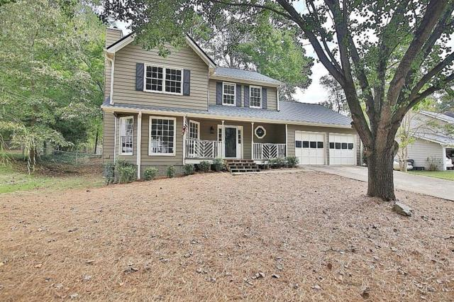 5081 Sugar Creek Drive, Sugar Hill, GA 30518 (MLS #6085147) :: The North Georgia Group