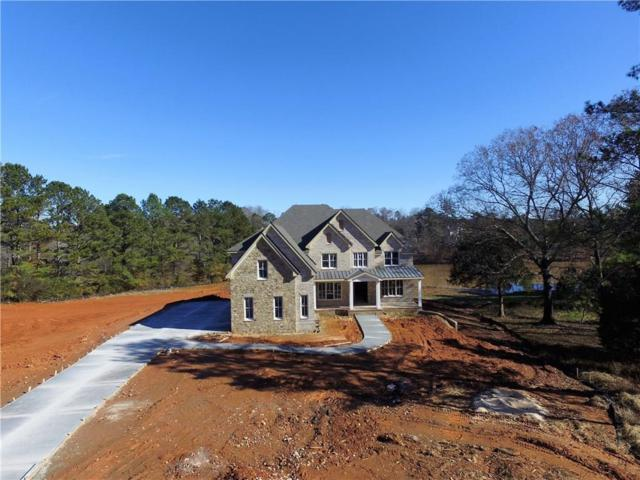 12635 Water's Edge Drive, Milton, GA 30004 (MLS #6098811) :: The North Georgia Group