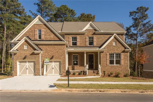 241 Harmny Lake Drive, Holly Springs, GA 30115 (MLS #6116162) :: North Atlanta Home Team