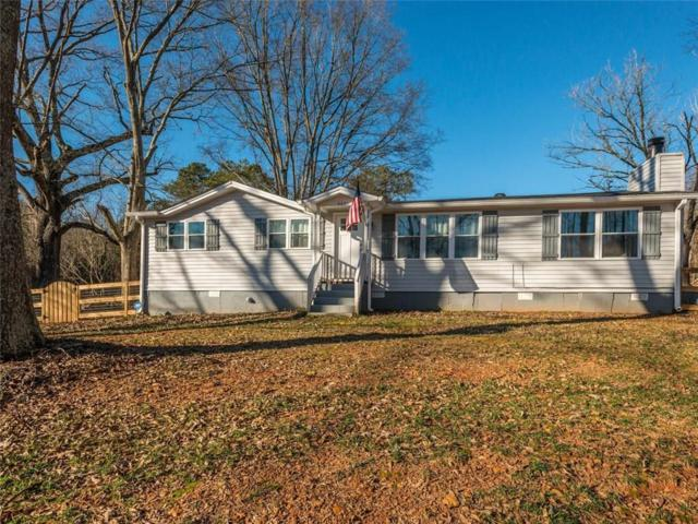 4031 N Arnold Mill Road, Woodstock, GA 30188 (MLS #6117796) :: Path & Post Real Estate