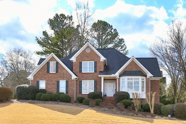 1355 Country Lake Drive SW, Lilburn, GA 30047 (MLS #6127793) :: North Atlanta Home Team