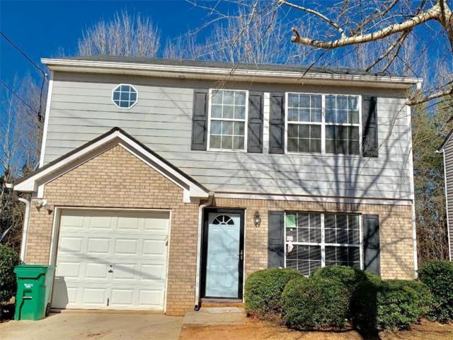 7074 Ravenwood Lane, Lithonia, GA 30038 (MLS #6129211) :: North Atlanta Home Team