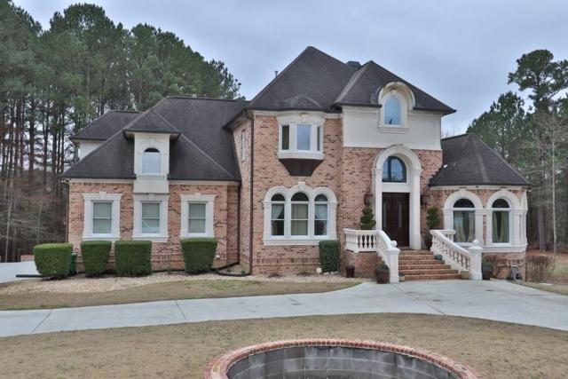 8499 Norris Lake Way, Snellville, GA 30039 (MLS #6507394) :: North Atlanta Home Team