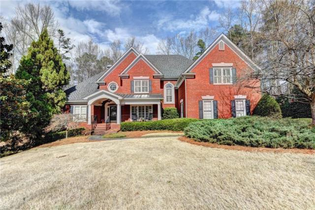 7040 Laurel Oak Drive, Suwanee, GA 30024 (MLS #6508427) :: Todd Lemoine Team