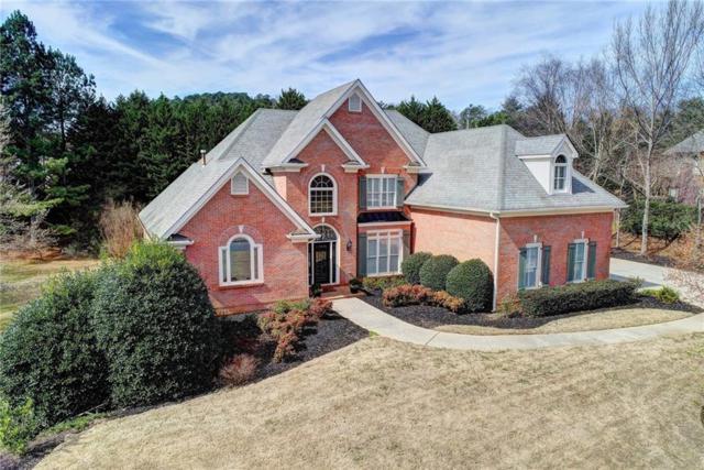 5835 Stoneleigh Drive, Suwanee, GA 30024 (MLS #6513565) :: North Atlanta Home Team