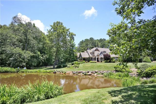 940 Pleasant Hollow Trail, Alpharetta, GA 30004 (MLS #6523389) :: Path & Post Real Estate