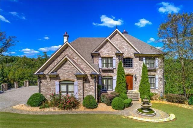 8560 Spyglass Drive, Duluth, GA 30097 (MLS #6524094) :: Iconic Living Real Estate Professionals