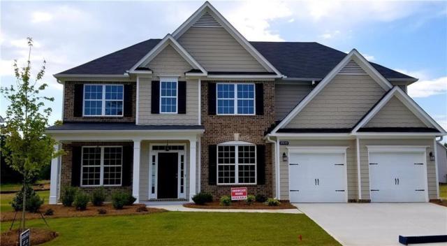 511 Coachman Drive, Holly Springs, GA 30115 (MLS #6549759) :: RE/MAX Paramount Properties