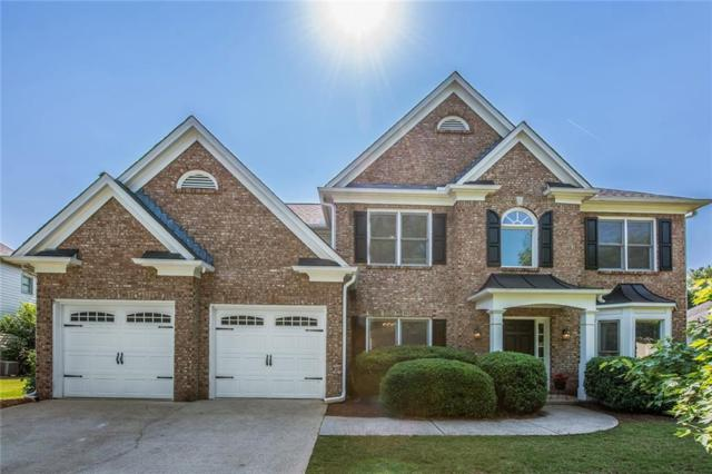 11025 Regal Forest Drive, Johns Creek, GA 30024 (MLS #6551878) :: Dillard and Company Realty Group