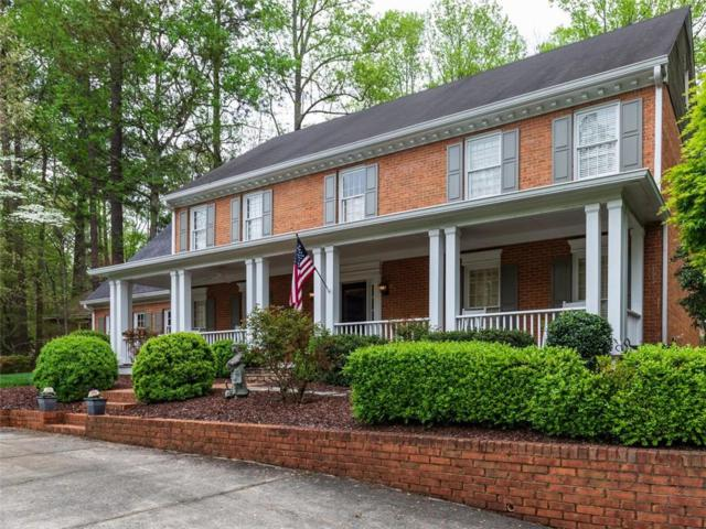 9985 Huntcliff Trace, Sandy Springs, GA 30350 (MLS #6555078) :: The Zac Team @ RE/MAX Metro Atlanta