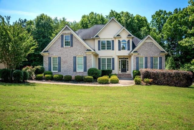 4820 Magnolia Creek Drive, Cumming, GA 30028 (MLS #6555303) :: The Zac Team @ RE/MAX Metro Atlanta
