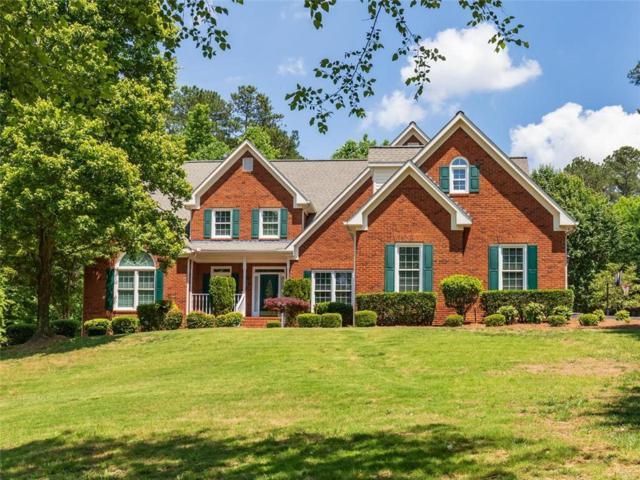 4855 Moore Road, Suwanee, GA 30024 (MLS #6556185) :: Iconic Living Real Estate Professionals