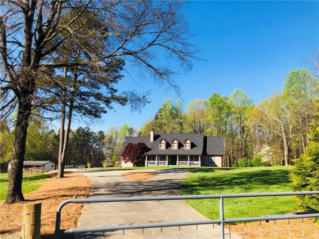 6055 Jackson Trail Road, Hoschton, GA 30548 (MLS #6556661) :: The Zac Team @ RE/MAX Metro Atlanta