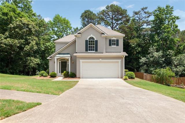 5028 Wesleyan Drive, Woodstock, GA 30189 (MLS #6558677) :: Charlie Ballard Real Estate