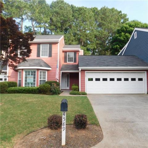 4589 Village Oaks Circle, Dunwoody, GA 30338 (MLS #6559975) :: North Atlanta Home Team