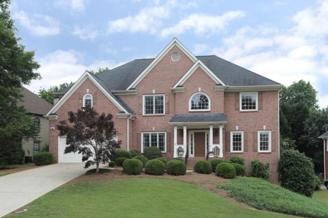 4055 Regal Oaks Drive, Suwanee, GA 30024 (MLS #6565228) :: North Atlanta Home Team
