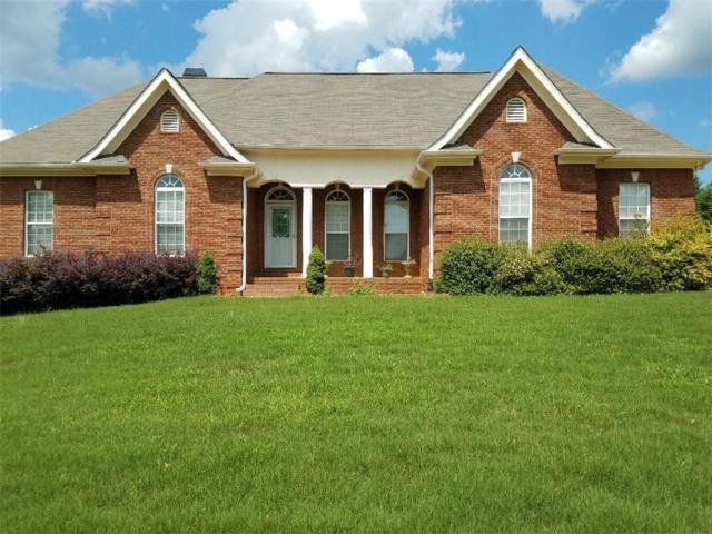 2527 Oak Creek Lane, Conyers, GA 30094 (MLS #6571335) :: The Heyl Group at Keller Williams
