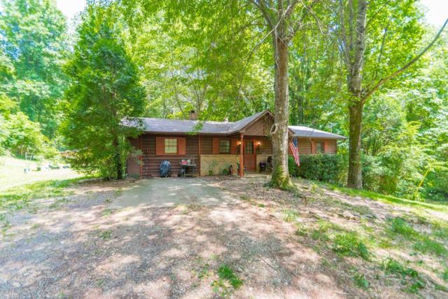 828 Old Magnolia Way, Canton, GA 30115 (MLS #6571389) :: Rock River Realty