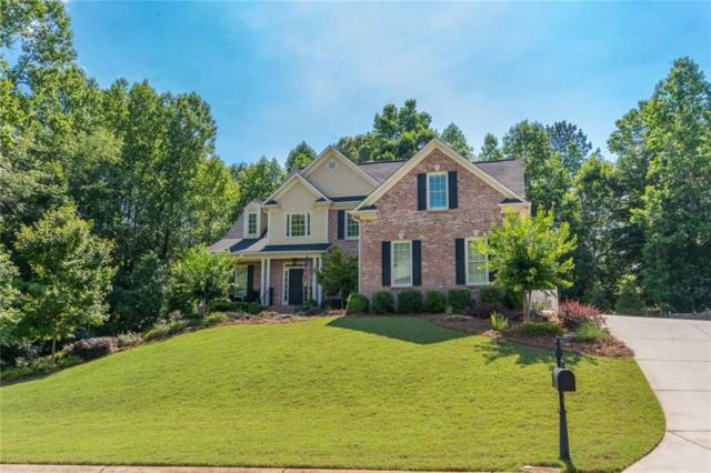 7630 Pleasant Hollow Lane, Cumming, GA 30041 (MLS #6571852) :: RE/MAX Paramount Properties