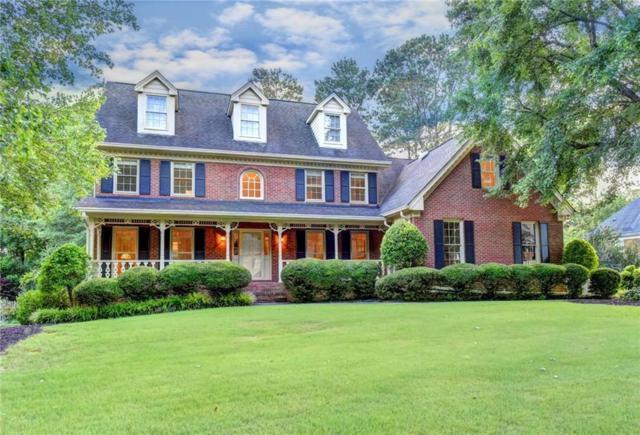 827 Guinevere Way SW, Lilburn, GA 30047 (MLS #6573312) :: North Atlanta Home Team