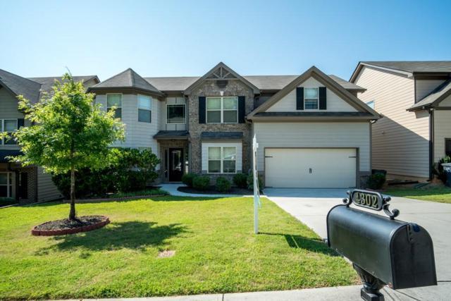 4302 Suwanee Mill Drive, Buford, GA 30518 (MLS #6579590) :: North Atlanta Home Team