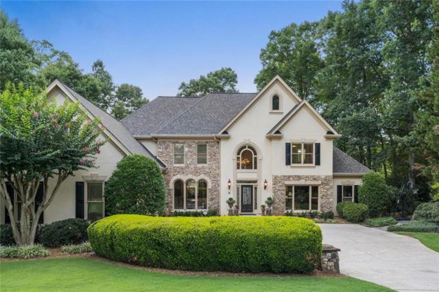 9095 Nesbit Lakes Drive, Alpharetta, GA 30022 (MLS #6586946) :: North Atlanta Home Team