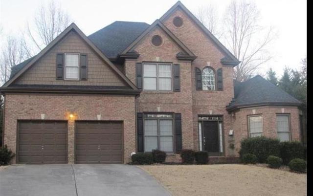 6445 Grand Magnolia Drive, Sugar Hill, GA 30518 (MLS #6592115) :: North Atlanta Home Team
