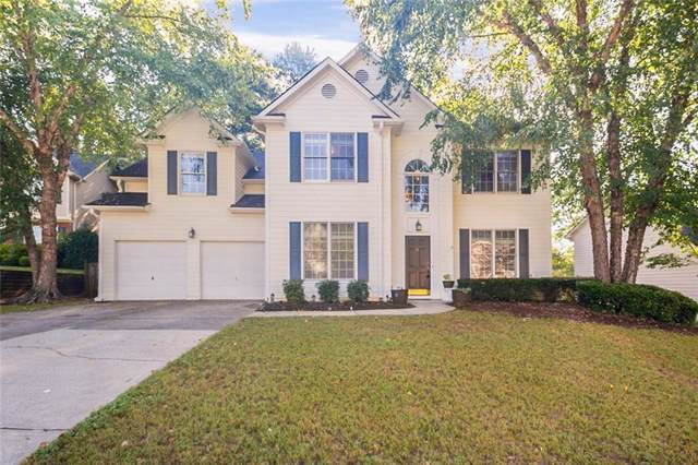 4146 Spring Hill Lane NW, Kennesaw, GA 30144 (MLS #6603611) :: The Heyl Group at Keller Williams