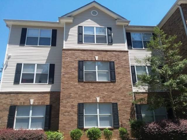 7101 Par Four Way, Lithonia, GA 30038 (MLS #6603964) :: The Zac Team @ RE/MAX Metro Atlanta
