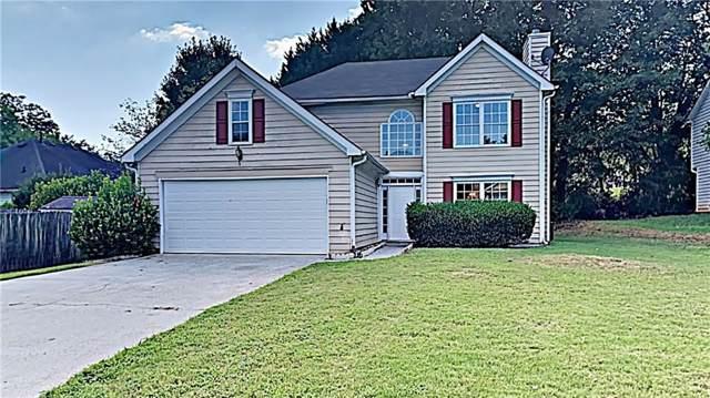 239 Kylman Court NW, Lilburn, GA 30047 (MLS #6605381) :: North Atlanta Home Team