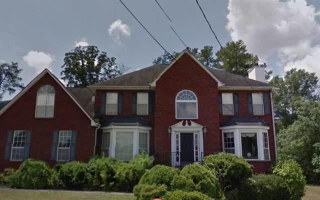 1587 Smithson Drive, Lithonia, GA 30058 (MLS #6615530) :: North Atlanta Home Team