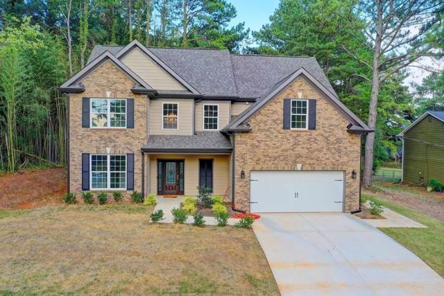 398 Wayward Wind Drive SW, Lilburn, GA 30047 (MLS #6620354) :: North Atlanta Home Team